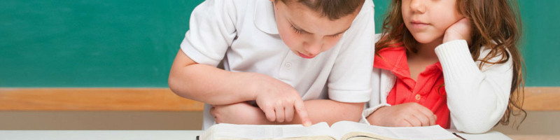 boy and girl reading a bible